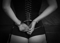 Woman in a Corset and Cuffs - Randy Fox
